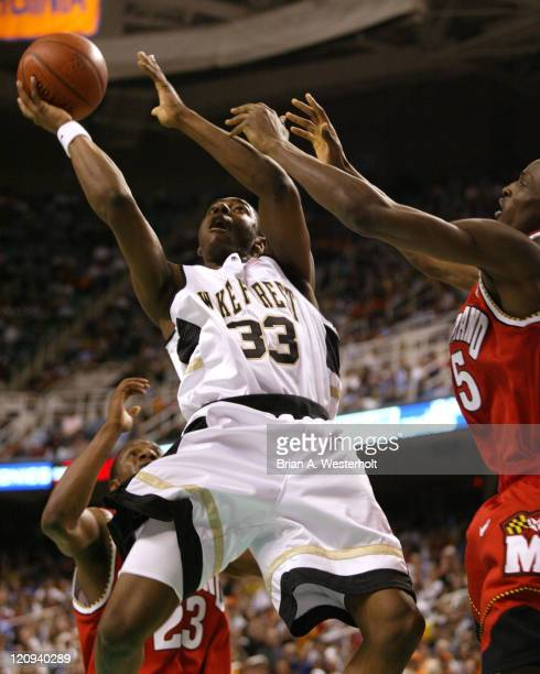 Trent Strickland tries to drive the lane past Ekene Ibekwe during first half action, March 12, 2004.