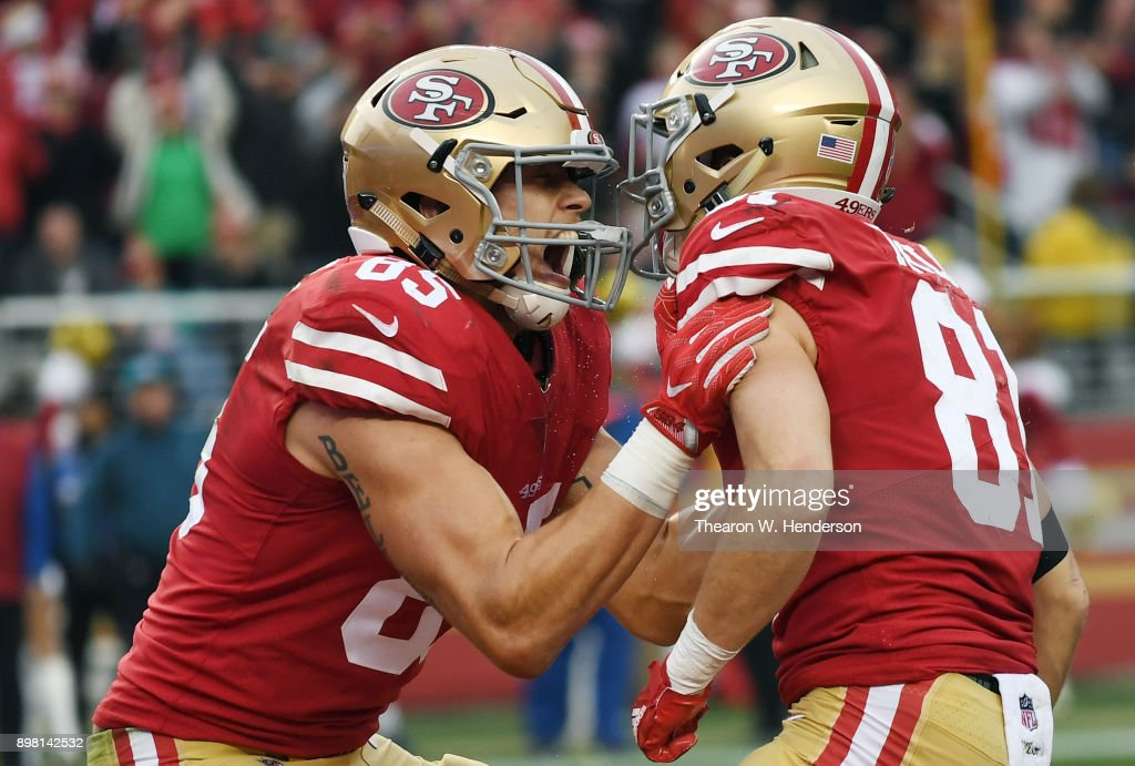 Trent Taylor #81 and George Kittle #85 of the San Francisco 49ers celebrates after Taylor caught a touchdown pass against the Jacksonville Jaguars during their NFL football game at Levi's Stadium on December 24, 2017 in Santa Clara, California.