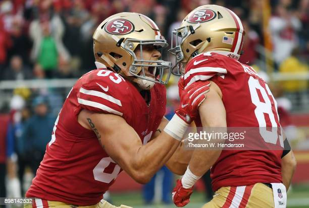 Trent Taylor and George Kittle of the San Francisco 49ers celebrates after Taylor caught a touchdown pass against the Jacksonville Jaguars during...