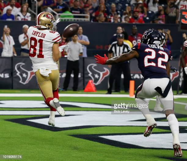 Trent Taylor of the San Francisco 49ers catches a pass for a touchdown as slips past Aaron Colvin of the Houston Texans in the first quarter during a...