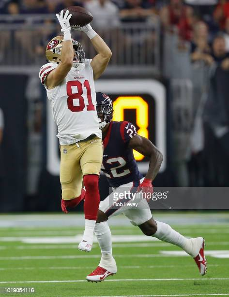 Trent Taylor of the San Francisco 49ers cateches a pass in front of Aaron Colvin of the Houston Texans during a preseason game at NRG Stadium on...