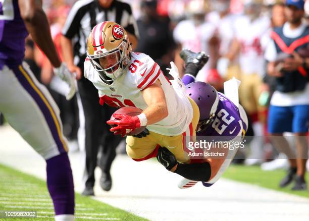 Trent Taylor of the San Francisco 49ers is tackled by Harrison Smith of the Minnesota Vikings in the fourth quarter of the game at US Bank Stadium on...