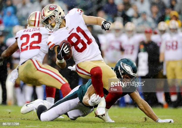 Trent Taylor of the San Francisco 49ers is taken down by Mack Hollins of the Philadelphia Eagles in the second half on October 29 2017 at Lincoln...