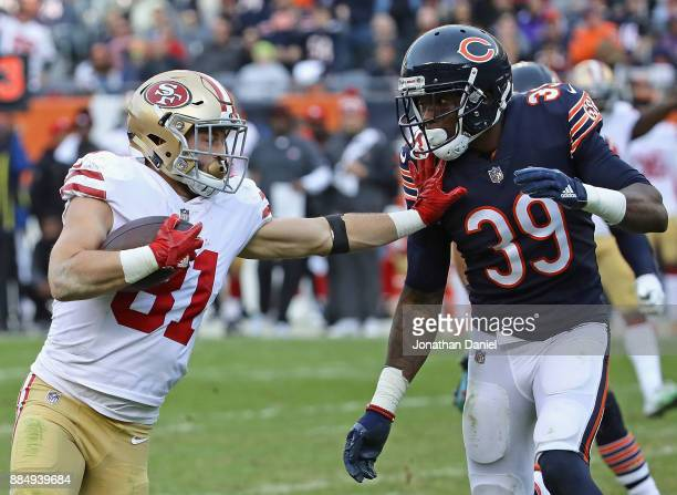 Trent Taylor of the San Francisco 49ers tries to hold off Eddie Jackson of the Chicago Bears on a 39 yard first down run after a catch at Soldier...