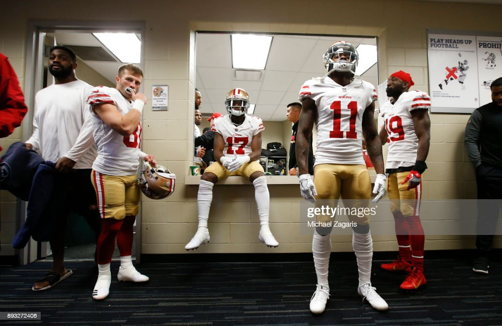 Trent Taylor #81, Victor Bolden Jr. #17, Marquise Goodwin #11 and Aldrick Robinson #19 of the San Francisco 49ers relax in the locker room prior to the game against the Houston Texans at NRG Stadium on December 10, 2017 in Houston, Texas. The 49ers defeated the Texans 26-16.