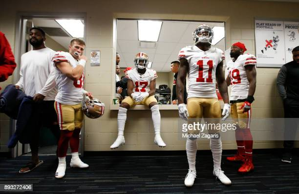 Trent Taylor Victor Bolden Jr #17 Marquise Goodwin and Aldrick Robinson of the San Francisco 49ers relax in the locker room prior to the game against...