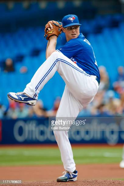 Trent Thornton of the Toronto Blue Jays prepares to throw a pitch during first inning of their MLB game against the Tampa Bay Rays at Rogers Centre...