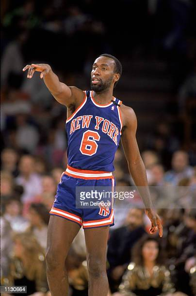 Trent Tucker of the New York Knicks points his finger during an NBA game against the Denver Nuggets at McNichols Sports Arena in Denver Colorado in...
