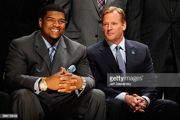 Trent Williams from the Oklahoma Sooners sits with NFL Commissioner Roger Goodell during the first round of the 2010 NFL Draft at Radio City Music...