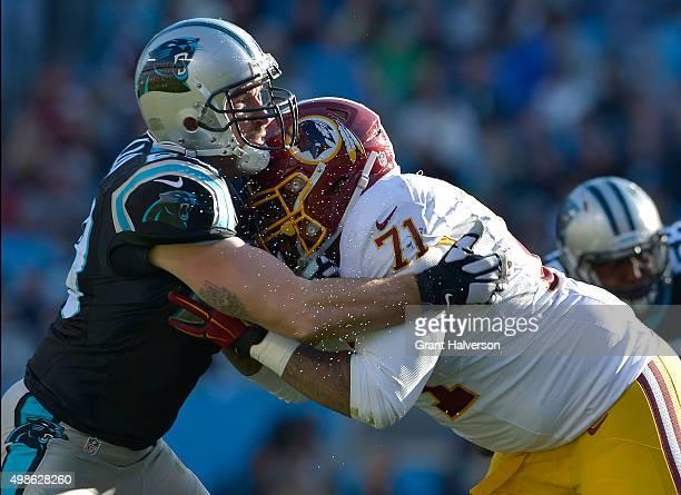 Trent Williams of the Washington Redskins blocks Jared Allen of the Carolina Panthers during their game at Bank of America Stadium on November 22...