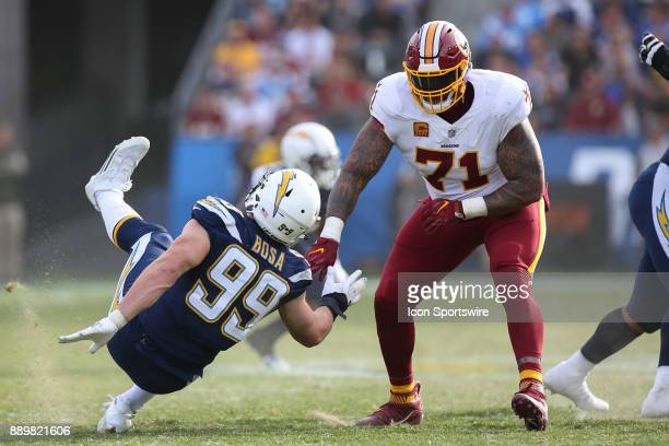 Trent Williams of the Washington Redskins throws Joey Bosa of the Los Angeles Chargers to the grass during a NFL game between the Washington Redskins...