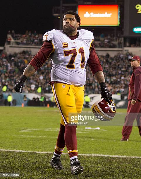 Trent Williams of the Washington Redskins walks off the field at the end of the first half against the Philadelphia Eagles on December 26 2015 at...