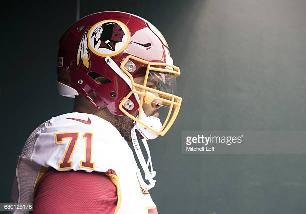 Trent Williams of the Washington Redskins walks onto the field prior to the game against the Philadelphia Eagles at Lincoln Financial Field on...