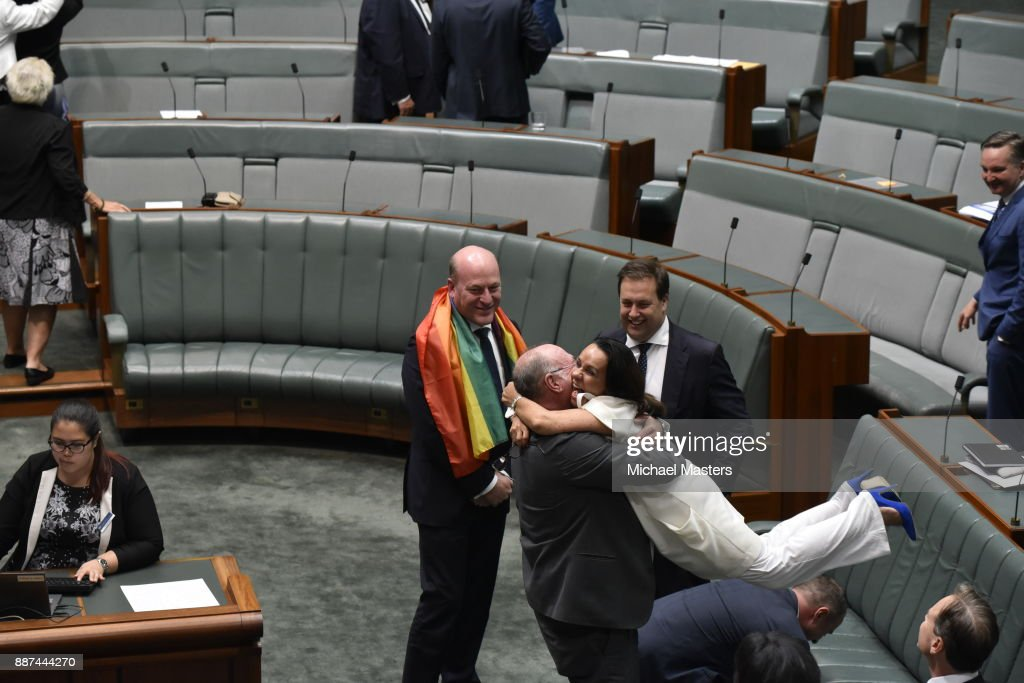 Trent Zimmerman and MP Linda Burney celebrate at Parliament House on December 7, 2017 in Canberra, Australia. The historic bill was passed on the voices and no count was made due to the overwhelming support for the bill on the final day of sitting for 2017. The legislation means same-sex couples will now be able to be legally married in Australia. Australians voted 'Yes' in the Marriage Law Postal Survey for the law to be changed in November.