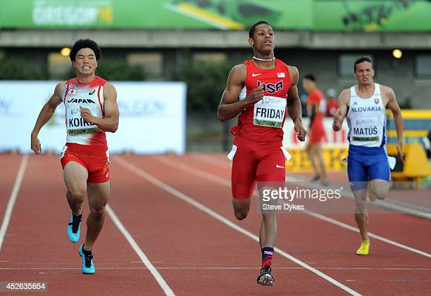 Trentavis Friday of USA crosses this finish line ahead of Yuki Koike of Japan and Jakub Matus of Slovakia in the semi-final of the men's 200m during...