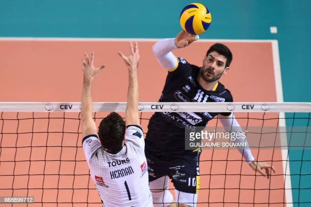 Trentino's Czech opposite Jan Stokr hits the ball during the CEV Cup men's final between Tours and Trentino on April 15 in Tours / AFP PHOTO /...