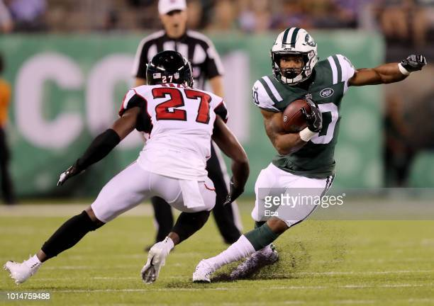 Trenton Cannon of the New York Jets carries the ball as Damontae Kazee of the Atlanta Falcons defends during a preseason game at MetLife Stadium on...