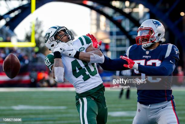 Trenton Cannon of the New York Jets drops a pass as he is defended by Kyle Van Noy of the New England Patriots during the third quarter of a game at...
