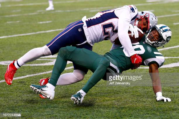 Trenton Cannon of the New York Jets is tackled by Patrick Chung of the New England Patriots during the fourth quarter at MetLife Stadium on November...