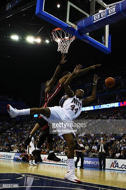 Trenton Hassell of New Jersey Nets is fouled by Udonis Haslem the Miami Heat during the NBA preseason game as part of the 2008 NBA Europe Live Tour...