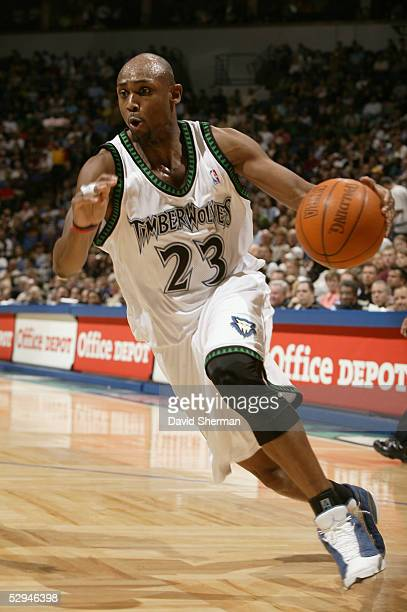 Trenton Hassell of the Minnesota Timberwolves drives against the San Antonio Spurs during the game at Target Center on April 20 2005 in Minneapolis...