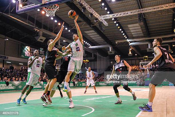 Trenton Meacham of JSF Nanterre shoots the ball against Bogdan Bogdanovic of Partizan NIS Belgrade during the game JSF Nanterre v Partizan NIS...