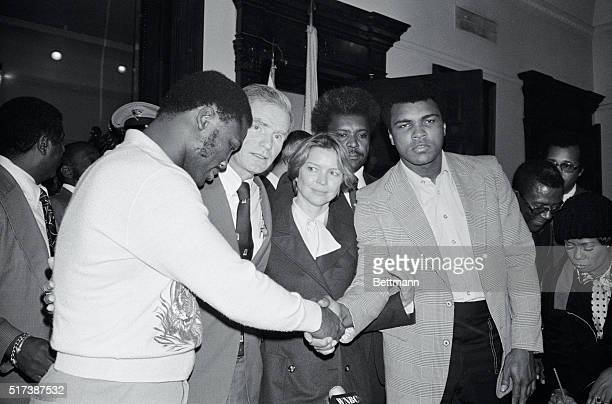 World heavyweight champ Muhammad Ali and former champ Joe Frazier shake hands after they and actress Ellen Burstyn met with New Jersey Governor...