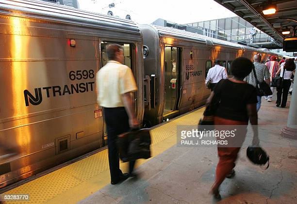 Passengers get off trains on the first day of new security proceedures enacted at various train and subway stations across the US 25 July 2005 in...