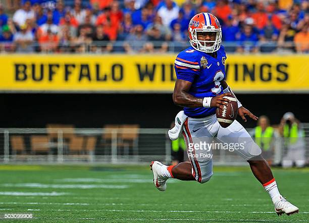 Treon Harris of the Florida Gators carries during the first half of the Buffalo Wild Wings Citrus Bowl game against the Michigan Wolverines at...