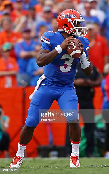 Treon Harris of the Florida Gators drops back to pass during the first quarter of the game against the Florida Atlantic Owls at Ben Hill Griffin...