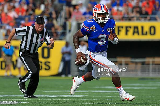 Treon Harris of the Florida Gators in action during the Buffalo Wild Wings Citrus Bowl game against the Michigan Wolverines at the Orlando Citrus...