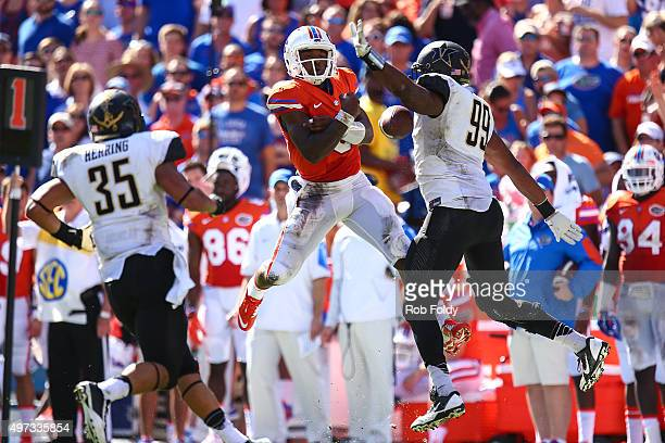 Treon Harris of the Florida Gators misses the ball on a trick play as Landon Stokes of the Vanderbilt Commodores defends during the first half of the...