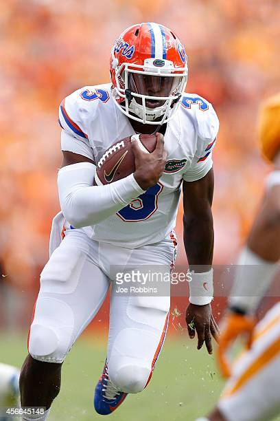 Treon Harris of the Florida Gators runs with the ball in the second half of the game against the Tennessee Volunteers at Neyland Stadium on October 4...