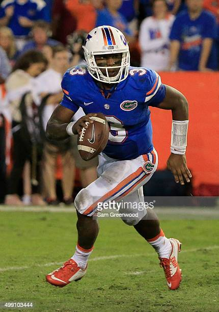 Treon Harris of the Florida Gators scrambles for yardage during the game against the Florida State Seminoles at Ben Hill Griffin Stadium on November...