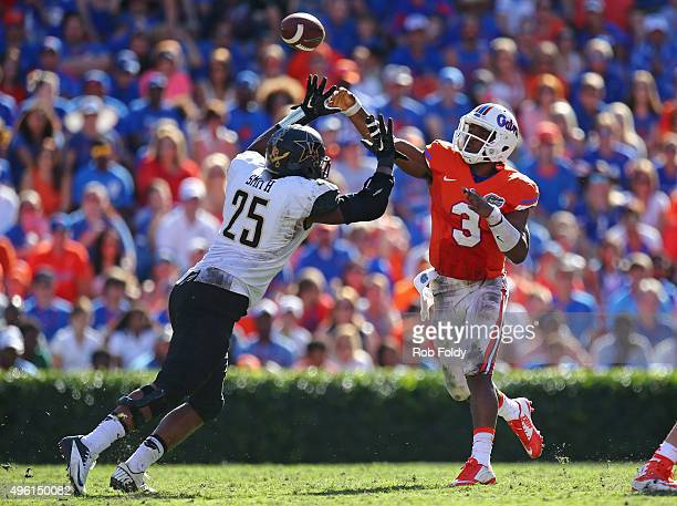 Treon Harris of the Florida Gators throws over Josh Smith of the Vanderbilt Commodores during the game at Ben Hill Griffin Stadium on November 7 2015...
