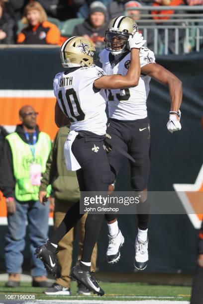 Tre'Quan Smith and Michael Thomas of the New Orleans Saints celebrate a touchdown during their game against the Cincinnati Bengals at Paul Brown...