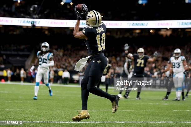 Tre'Quan Smith of the New Orleans Saints catches a 10 yard touchdown pass from Drew Brees against the Carolina Panthers during the first quarter in...