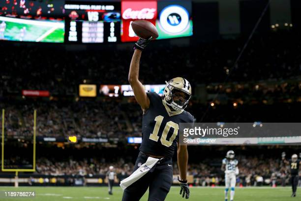 Tre'Quan Smith of the New Orleans Saints celebrates after scoring a 10 yard touchdown pass from Drew Brees against the Carolina Panthers during the...
