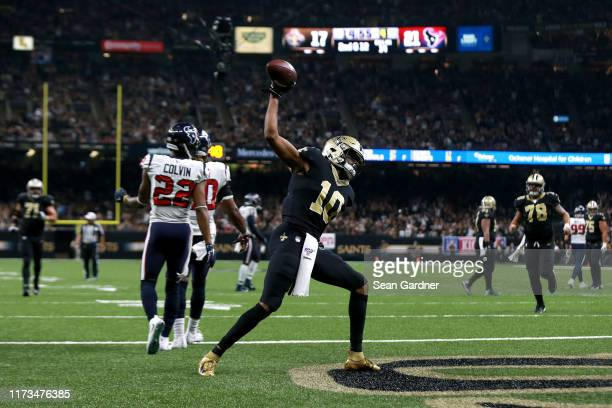 Tre'Quan Smith of the New Orleans Saints spikes the ball after scoring a touhdown against the Houston Texans during a NFL game at the Mercedes Benz...