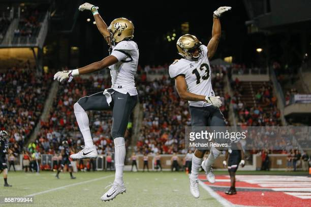 Tre'Quan Smith of the UCF Knights celebrates a touchdown with Gabriel Davis after a touchdown against the Cincinnati Bearcats during the first half...
