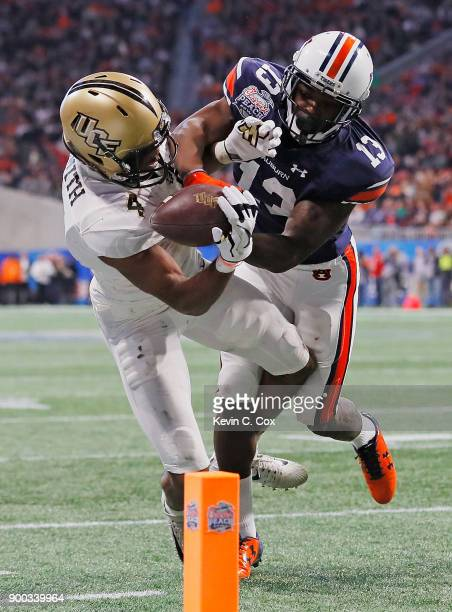 Tre'Quan Smith of the UCF Knights is unable to make a reception against Javaris Davis of the Auburn Tigers in the second half during the ChickfilA...