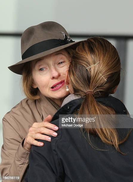 Tres Blue trainer Gai Waterhouse is kissed by Francesca Cumani during trackwork at Werribee Racecourse on October 30 2013 in Melbourne Australia