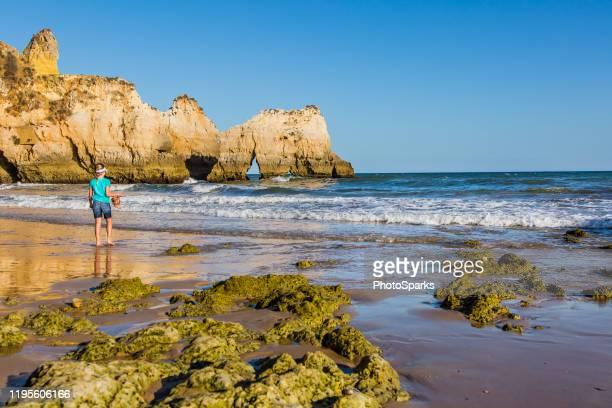 tres irmanos beach - três pessoas stock pictures, royalty-free photos & images
