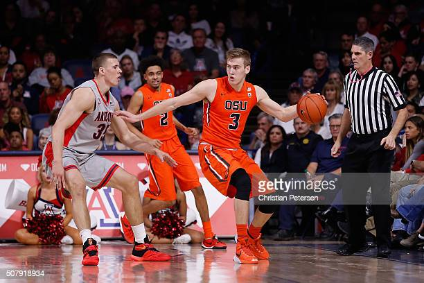 Tres Tinkle of the Oregon State Beavers handles the ball during the college basketball game against the Arizona Wildcats at McKale Center on January...