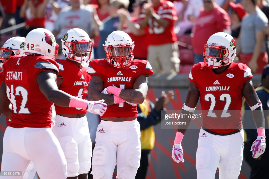 TreSean Smith #4 of the Louisville Cardinals reacts after intercepting a pass in the end zone in the second quarter of a game against the Boston College Eagles at Papa John's Cardinal Stadium on October 14, 2017 in Louisville, Kentucky.