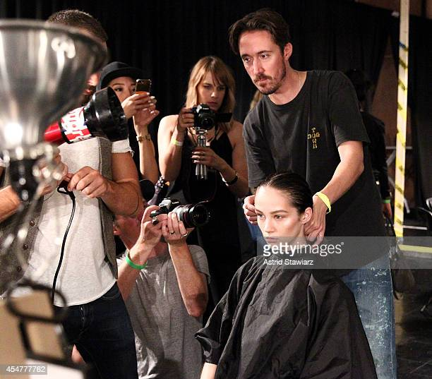 TRESemme hair stylist Paul Hanlon prepares backstage at the Prabal Gurung fashion show with TRESemme during MercedesBenz Fashion Week Spring 2015 at...