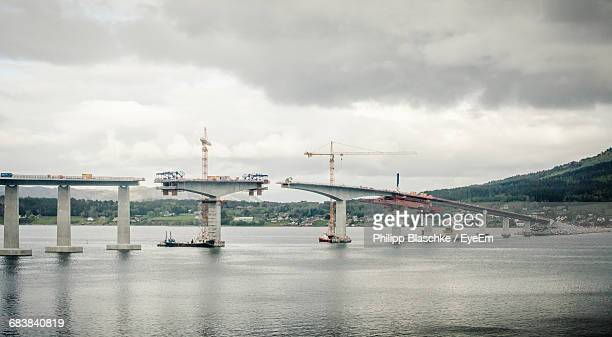 tresfjord bridge under construction over sea - bridge built structure stock pictures, royalty-free photos & images