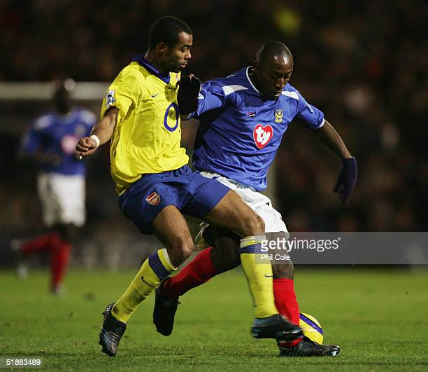 Tresor Lomana Lua Lua of Portsmouth holds off Ashley Cole of Arsenal during the Barclays Premiership match between Portsmouth and Arsenal at Fratton...
