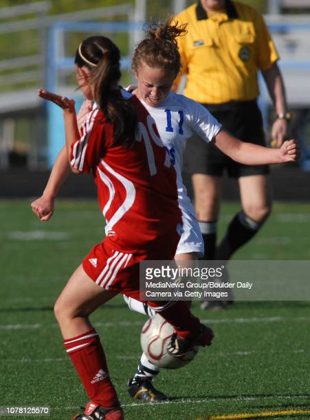 Tressa Thompson right Broomfield High School forces the ball past Liz Handing Steamboat Springs High School during the first round of state playoffs...