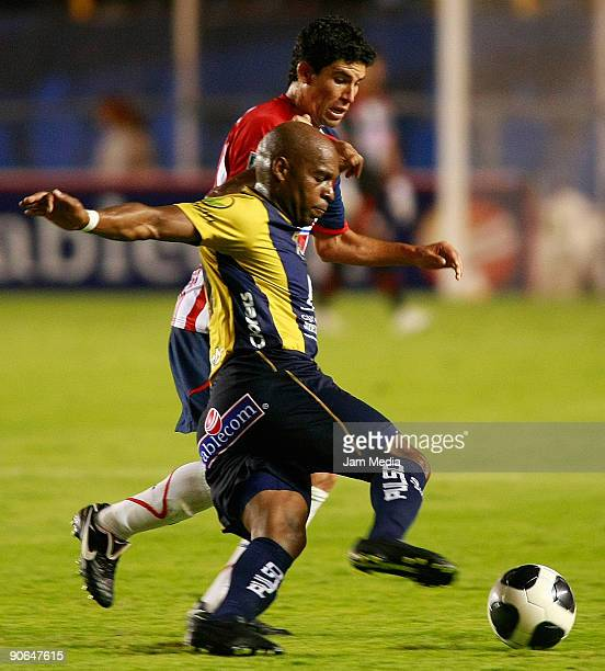 Tressor Moreno of San Luis and Jonny Magallon of Chivas during their match in the 2009 Opening tournament the closing stage of the Mexican Football...
